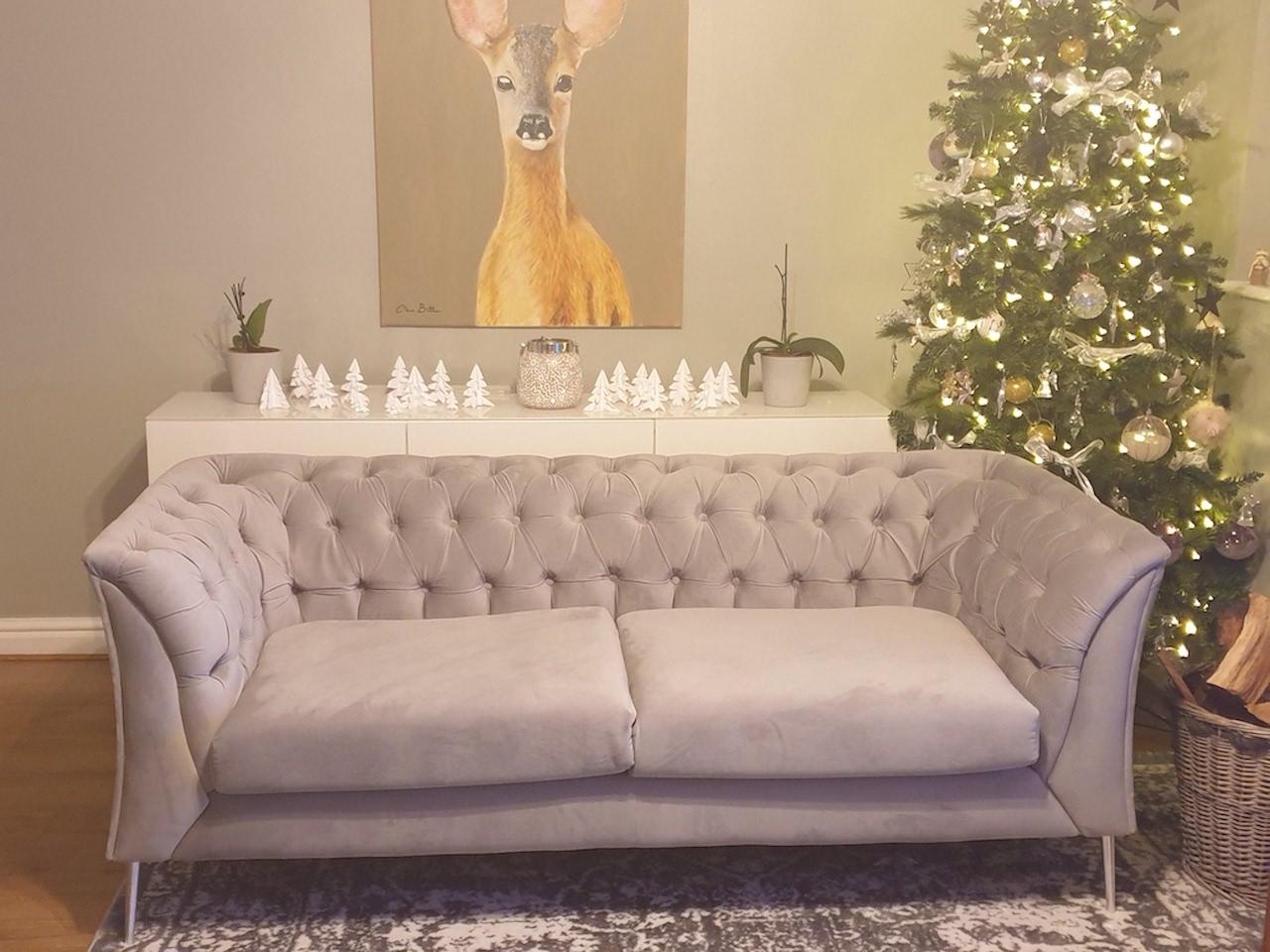 Chesterfield Modern grey sofa on silver legs, christmas decoration