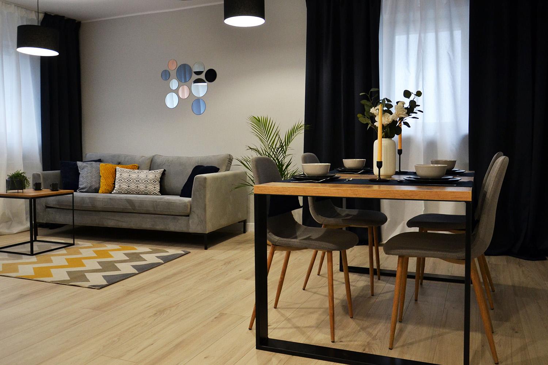 Grey 2,5 seater sofa Gosena on black legs