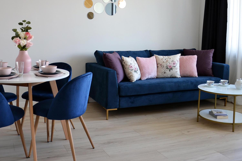 Gosena dark blue sofa on golden legs