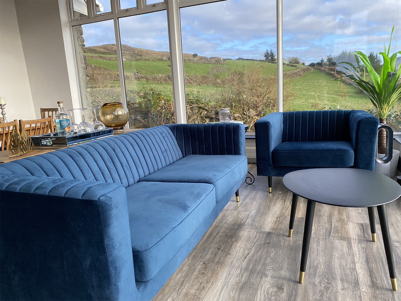 Slender navy blue sofas in a spacious living room